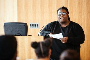 Danialie Fertile '16, who organized the College's Black Heritage Month events, introduces Yolanda Wisher '98.