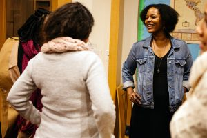 Yolanda Wisher '98 meets with students and faculty during a reception.