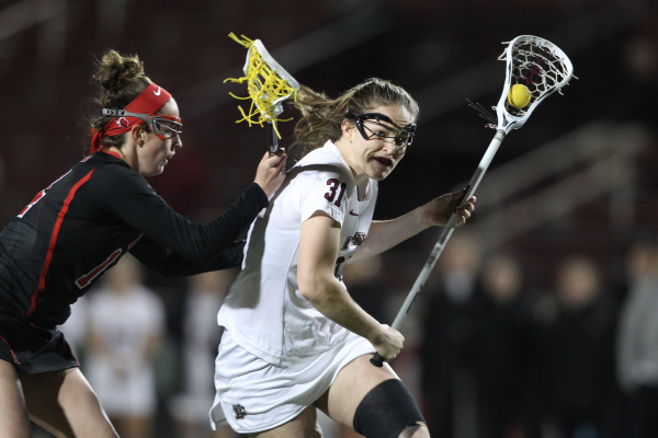 Kirsten Wilhelmsen '17 tries to elude a Rutgers defender during a women's lacrosse game.