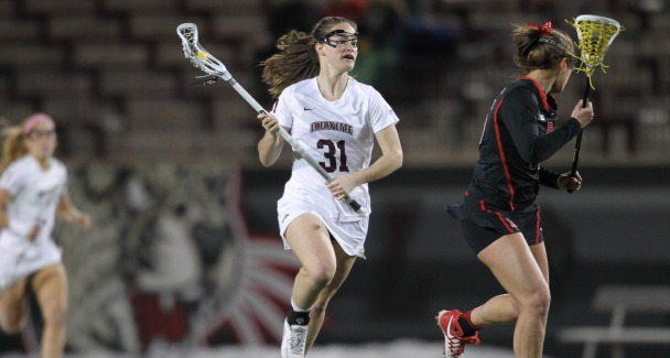 Kirsten Wilhelmsen '17 runs with the ball in her stick during a women's lacrosse game