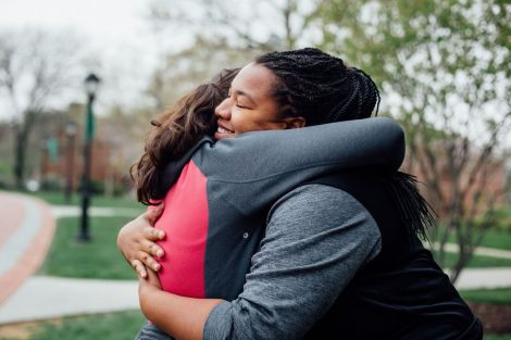 Two students hug during the Equality Rally.