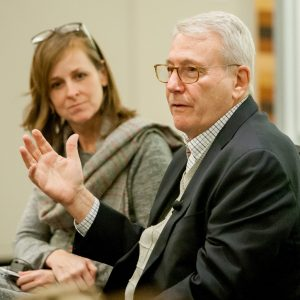 Bruce Maggin '65 speaks to Lafayette students while Susan Fox '88 listens next to him.
