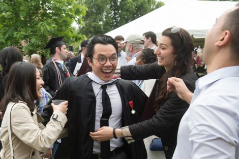 Friends celebrate after the Commencement ceremony.