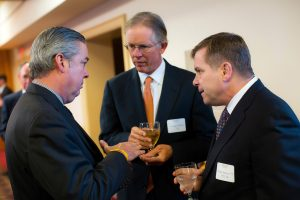 George Jenkins '74, center, with John Fry '82, left, and Peter Simon '75 at a Societe d'Honneur induction dinner in 2013.