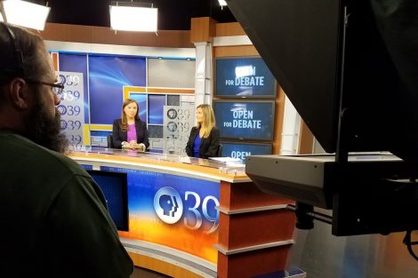 Hannah Doherty '19 and Natalie Gosnell '18, the two anchors for the Open for Debate, sit at the anchor desk