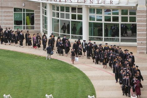 Students begin the walk to Commencement from Kirby Sports Center.