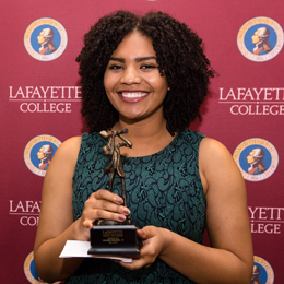 Valerie Melson '17 holds her Marquis Award