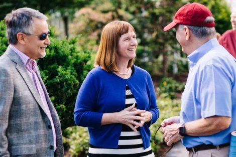 Alison Byerly talks with an alumnus.