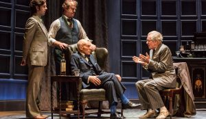 Ian McKellen and Patrick Stewart perform on stage with an actress in No Man's Land.
