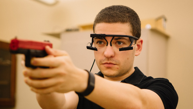 Noah Steinberg '17 shoots a laser pointer that's in the shape of a pistol.