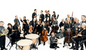 Members of Orpheus Chamber Orchestra talk to one another.