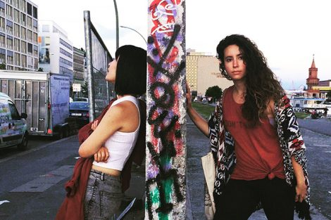 Danhui Zhang '18 and a friend stand at a remnant of the Berlin Wall. Submitted by Danhui Zhang '18