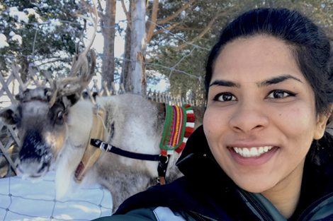 Jasmine Puri '18 and a reindeer in the Arctic Circle. Submitted by Jasmine Puri '18