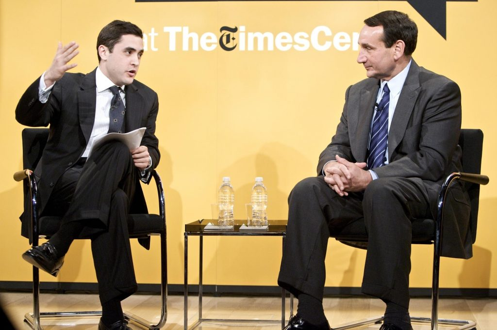 Schmidt (left) chats with Duke University men's basketball coach Mike Krzyzewski.