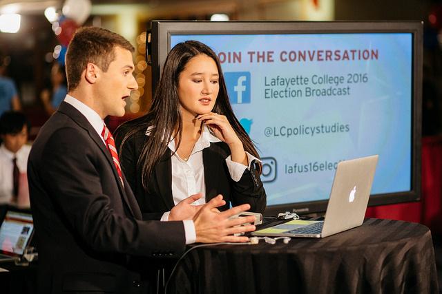 Election night students talk on camera.