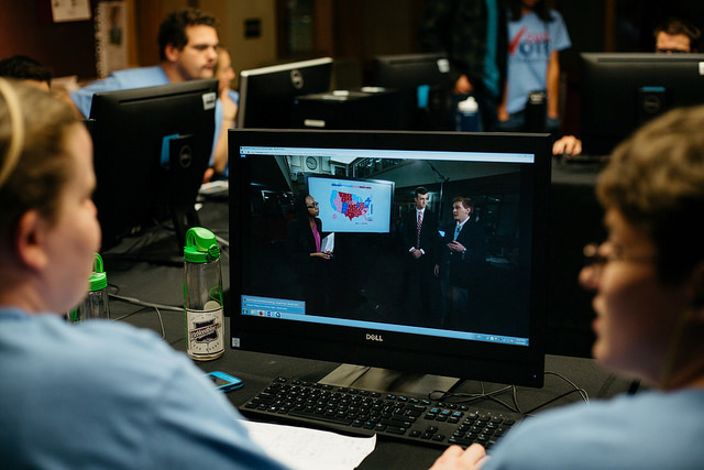 Students watch a monitor during the Election night broadcast.