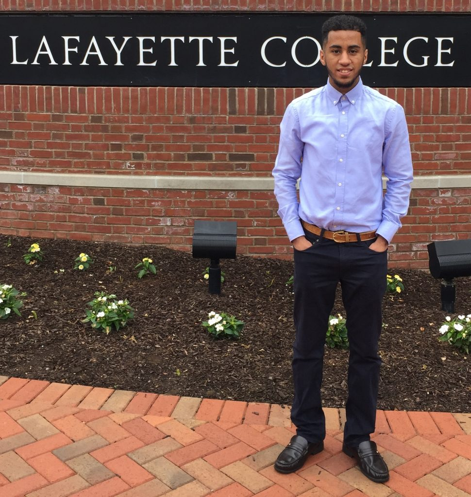 Tawfiq Alhamedi stands in front of a Lafayette College sign