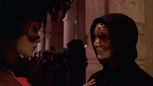 A man and a woman each wear a mask in the film Eyes Wide Shut.