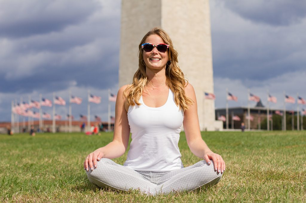 Kelsey Harkness '11 takes the lotus position in front of the Washington Monument.