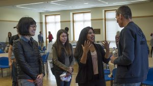 Chip Bergh '79 talks with three students after his presentation.