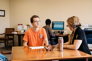 A student and a career counselor talk together.