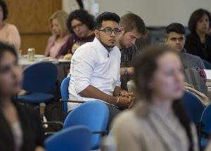 A student listens to Chip Bergh.