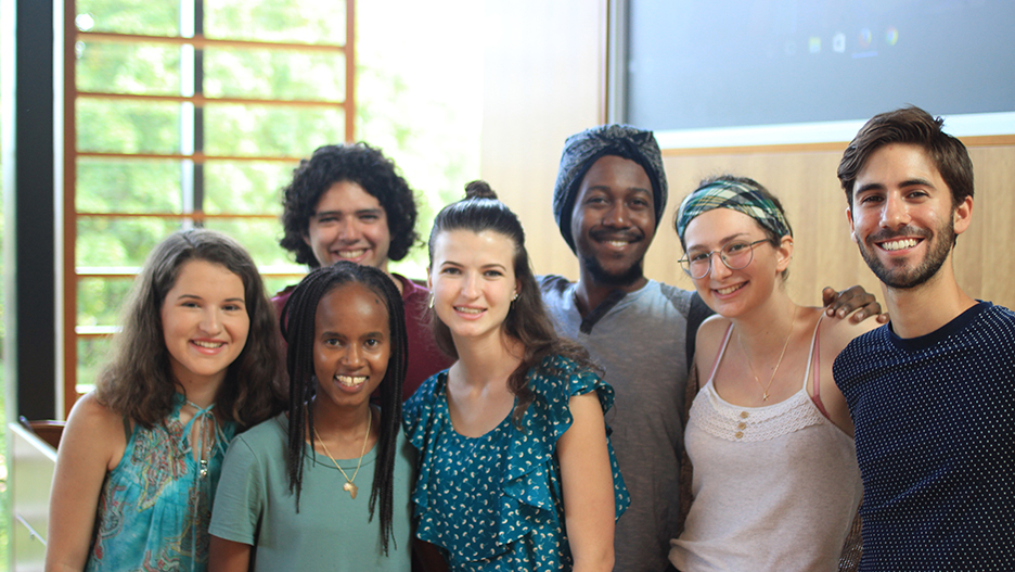 The seven digital humanities research students pose for a photograph.