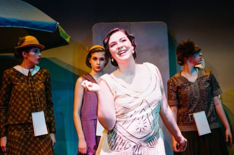 Actors in The Drowsy Chaperone rehearse on stage.