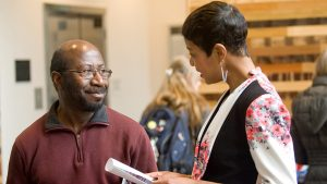 Rex Ahene talks with Terese Brown '07.