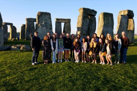 Students pose for a photo at Stonehenge.