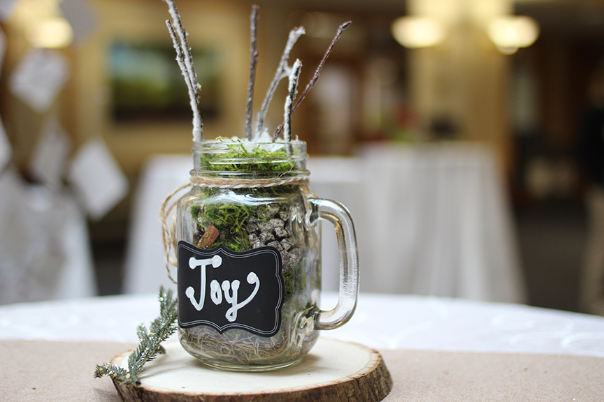 "A mug decoration with ""joy"" on the outside"