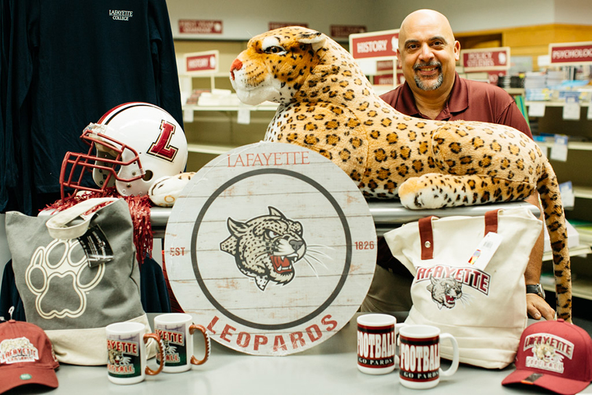 Chuck Corsi with merchandise in the College Store