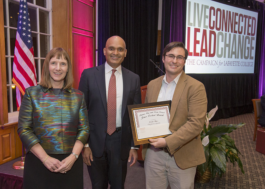 Lafayette President Alison Byerly, Provost Abu Rizvi, and Justin Hines, who is holding his Jones Lecture Award