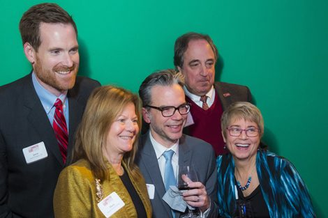 Five staff members pose at the NYC holiday party.