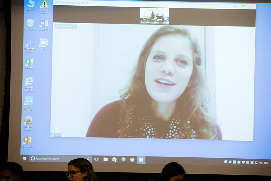 The image of Rachel Davidson Raycraft '13 is projected on an overhead screen as she participates in the forum via teleconferencing.