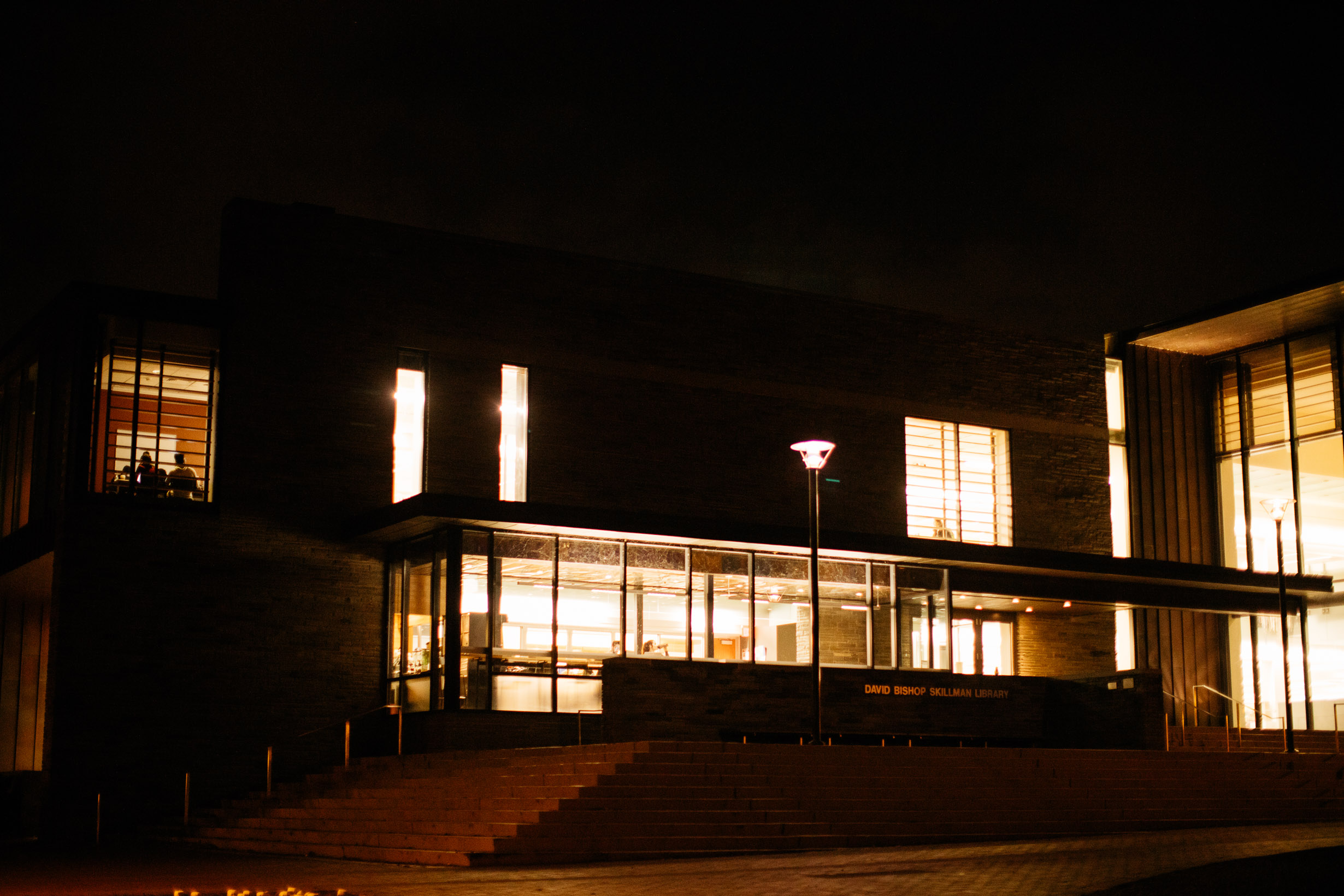 An exterior view of Skillman Library illuminated by LED lights at night