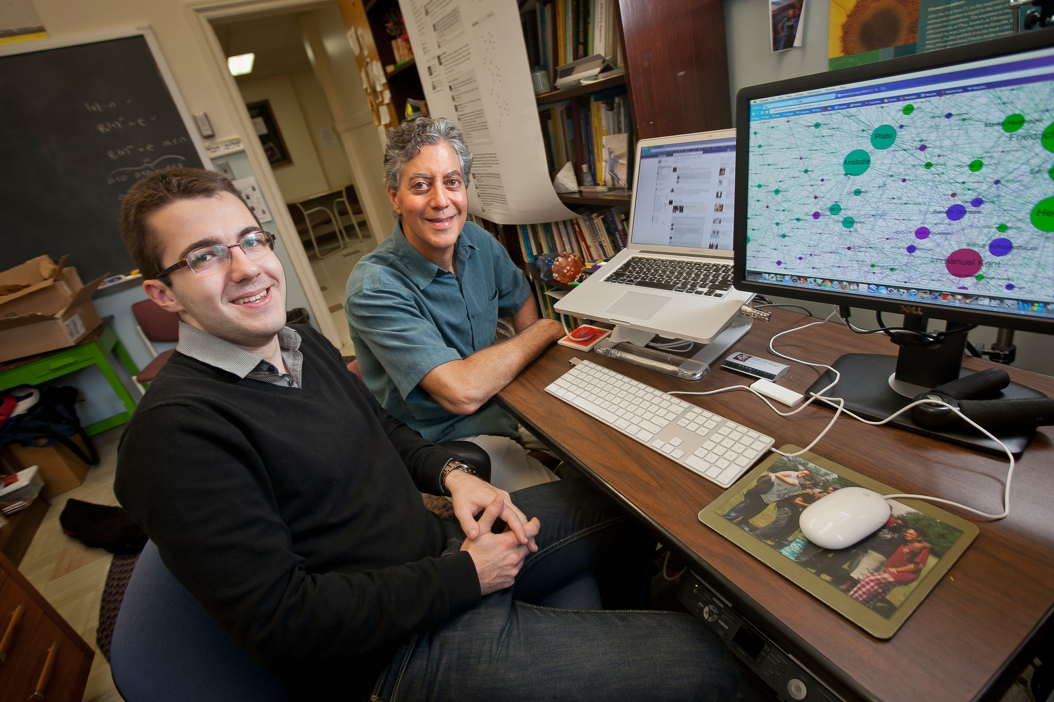 Math professor Gary Gordon and Dorde Radic '15 at Gordon's office computer