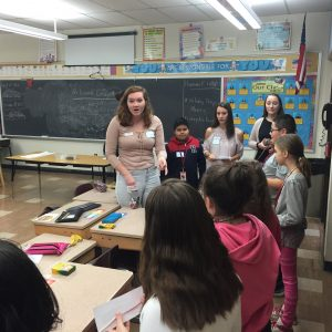 Lafayette student speaks with elementary school students.
