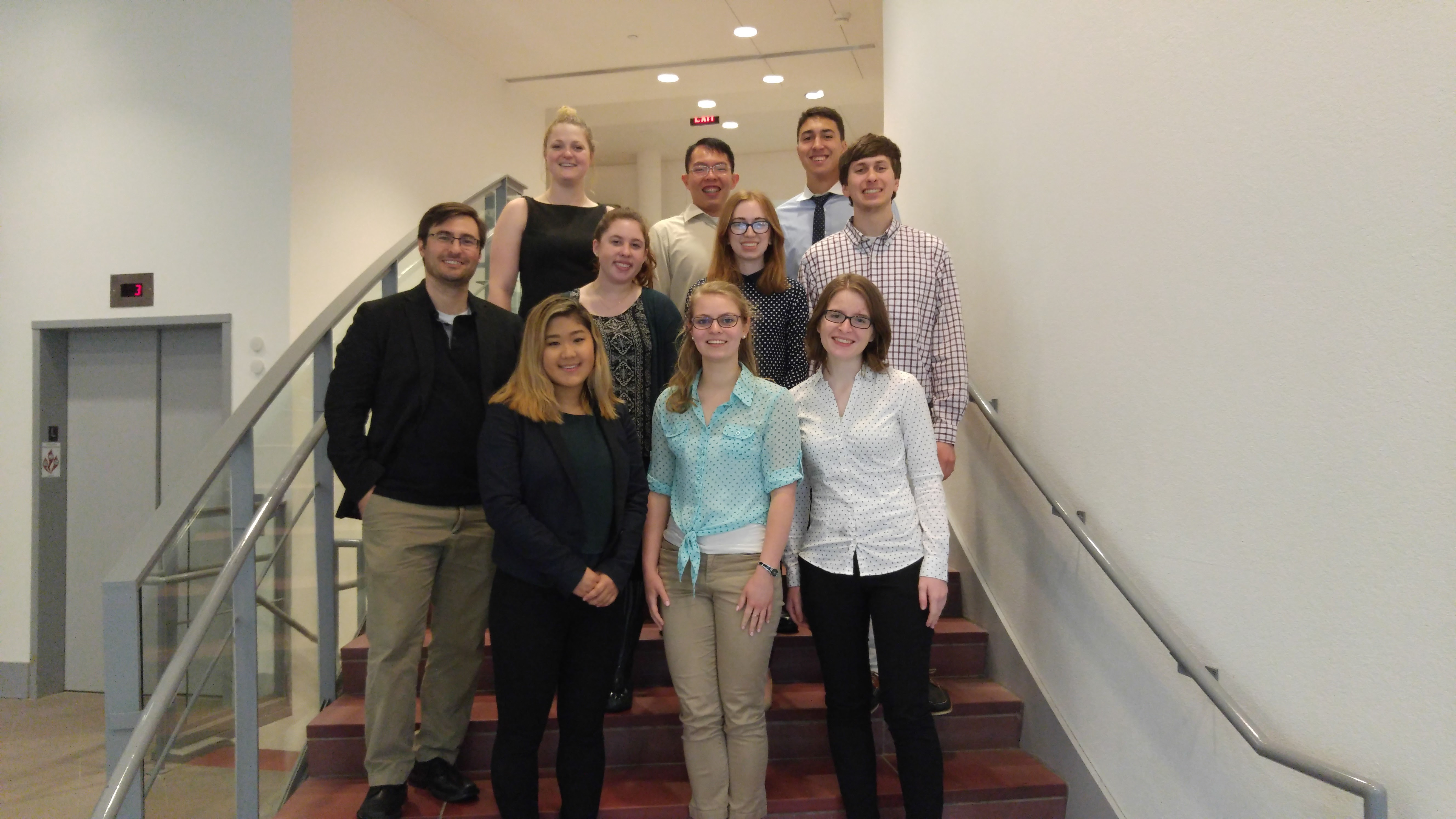 Professor Justin Hines (left) and his 2016-17 research students