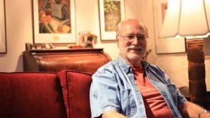 Prof. Dan Bauer on his couch at home