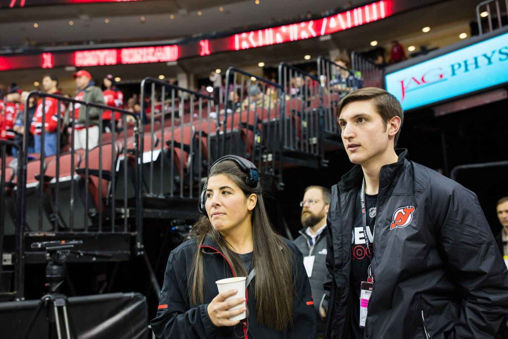 As part of their externship with the New Jersey Devils, Tymir Jones '18 and Matt Peters '19 experienced behind-the-scenes activities at an ice-hockey game with host Alexa Ikeler '13.
