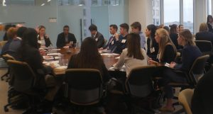 Students attend a meeting in an office in Boston.