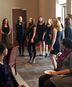 The Cadence a cappella group performs at the Dine 3/9 Brunch.