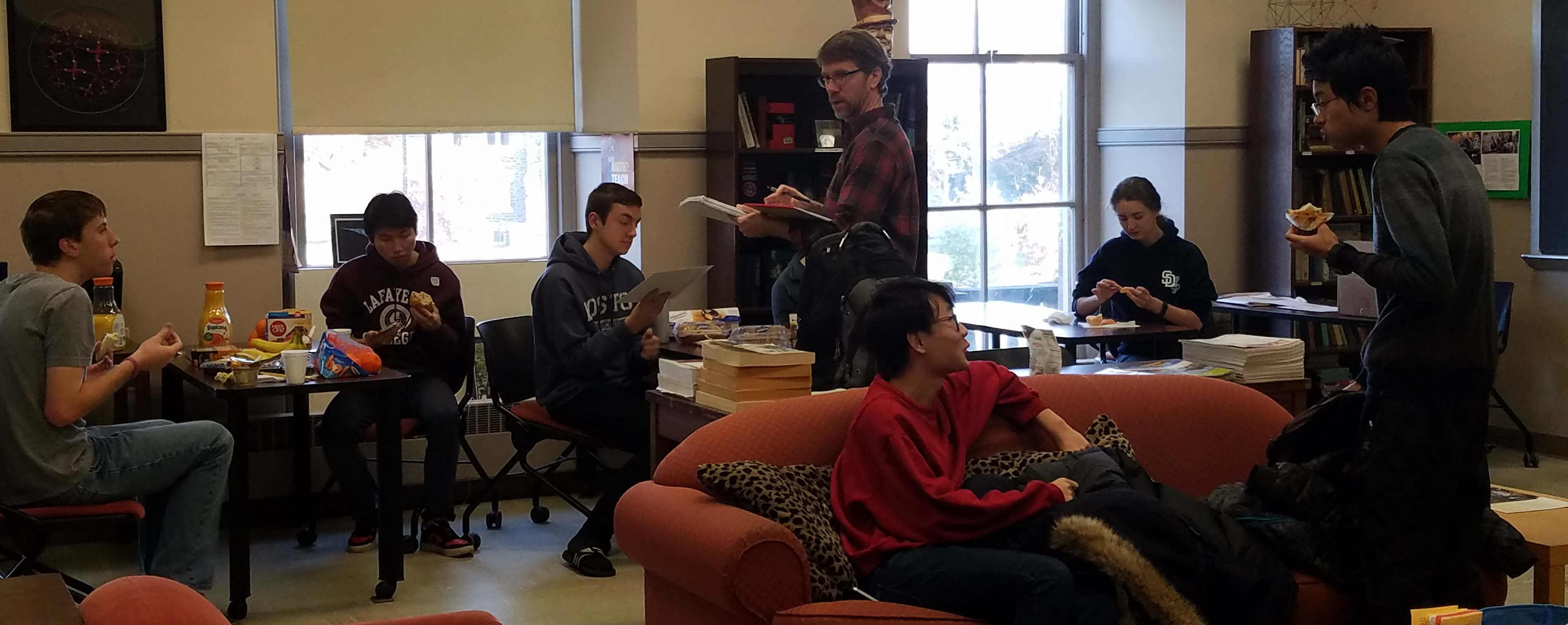 Professor Derek Smith and students discuss math problems from the Putnam Exam.