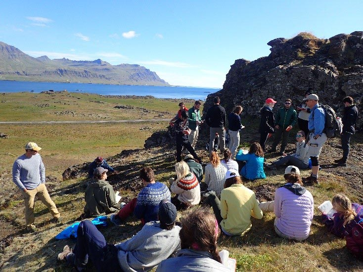 Professor Dave Sunderlin gives the class a lecture at Djúpavogshreppur, Iceland.