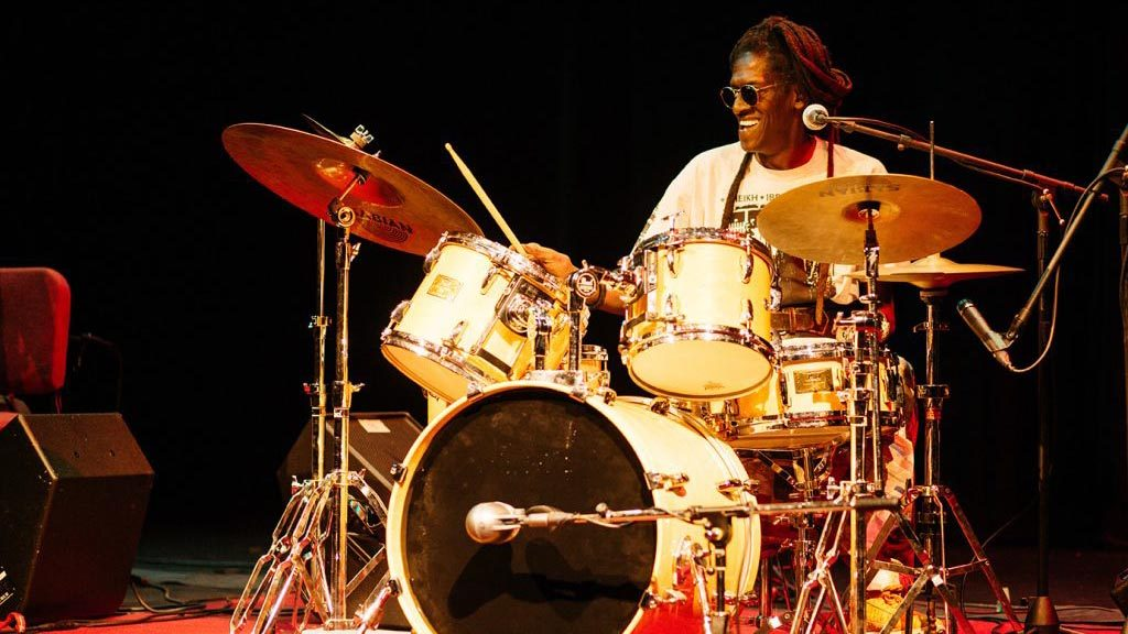 Drummer Cheikh Lo performs