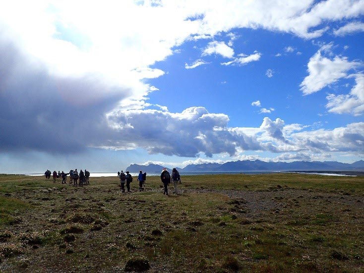 Beautiful clouds against a blue sky along with students in Iceland