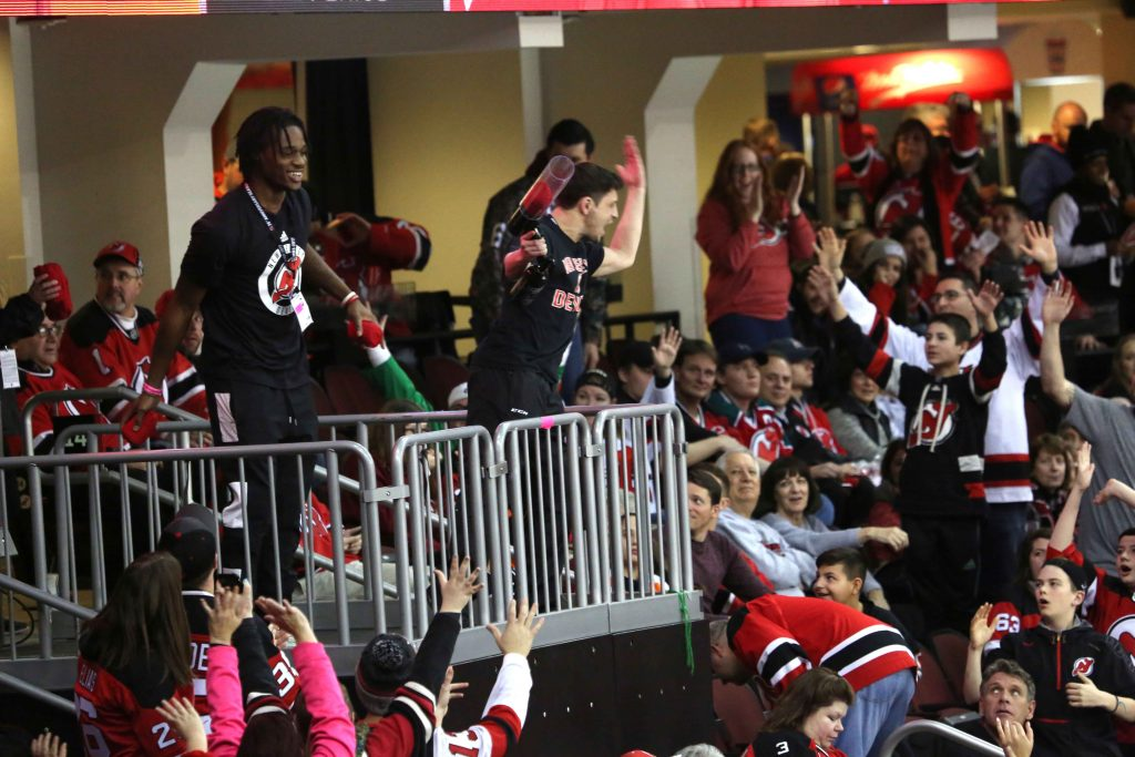 New Jersey Devils fans cheer.
