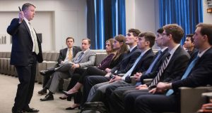 Students listen to an executive in a New York City office.