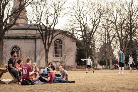 Students sit together on the Quad.